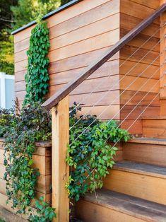 Creative Deck Rail Design Ideas | HGTV Outside Stair Railing, Horizontal Deck Railing, Outdoor Stair Railing, Deck Railing Design, Deck Stairs, Deck Railings, Deck Design, Deck Railing Ideas Diy, Garage Stairs