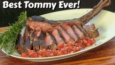 """Inspired by Santa Maria BBQ, this giant tomahawk ribeye was seasoned with a traditional Santa Maria blend, and mopped as it cooked with a fantastic basting liquid. I used my Sunterra Pro """"Fireside Grill"""" for this cook!"""