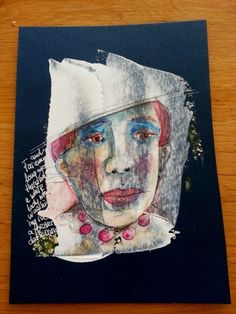 Vlekkenface 2 White acryl on blue paper. Then drew over it with fineliner and watercolour.