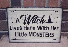 "Prim Style Halloween Witch Sign ""A Witch Lives Here with Her Little Monsters"" Handpainted. $26.99, via Etsy."