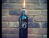 Monogrammed Wine Bottle Tiki Torch. $19.99, via Etsy.