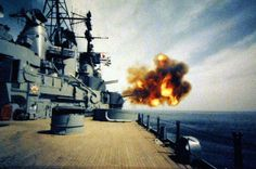 """USS New Jersey (BB 62) fires her 5"""" inch, 38 caliber guns. Photographed, May 23, 1968. Official U.S. Navy Photograph, now in the collections of the National Archives. Photographed from a small reference card."""