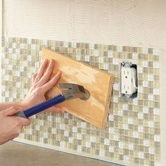Seat tiles firmly in the mastic by tapping a board
