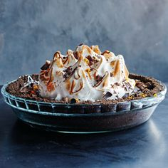 This black bottom pie recipe is a chocoholic's dream, with its crunchy crust, rich chocolate filling, bright orange zest and toasted meringue topping.