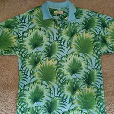 """Tommy Bahama LG Polo Silk Blend TOMMY BAHAMA mens SZ LG palm tree print SILK BLEND button front shirt?  EXCELLENT PRE-OWNED CONDITION?  LIGHT BLUE IN COLOR?  GREEN PALM TREE PRINT?  COCONUT SHELL BUTTONS?  BUTTON FRONT WITH COLLAR?  75% SILK & 25% COTTON?  MEASURES ACROSS - ? 23""""?  LENGTH ---- ?32""""?  SMOKE FREE HOME? Tommy Bahama Tops"""