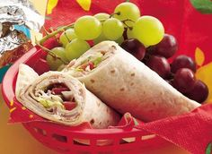 Flour tortillas blanket flavored cream cheese, turkey and fixings to create this fresh and fabulous sandwich wrap.