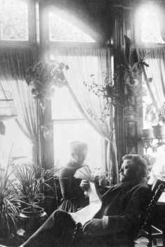 Captain and Mrs. Pabst relax in the conservatory of their first home next to the brewing company built in 1875.