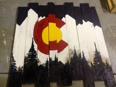 Pallet board and a little paint. Colorado Flag. Denver. I make these custom. I live in Charlotte, NC and more than happy to make any size or design.  Jfrance2@gmail.com if interested