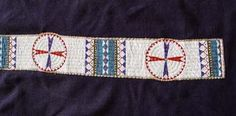 Sioux Beaded Blanket Strip on hide sewn on to a Blue Stroud Trade Cloth Shoulder Blanket.