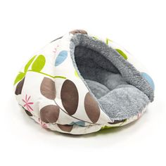 Cuddle your pet in the designer Retro styled Cozy Cave Bed. Lined with soft fleece for extra comfort, this bed will give your pet a sense of security unlike any other bed. Base diameter measures 22 in