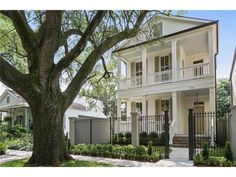 536 Nashville Ave, New Orleans. Historic white house with mushroom colored shutters. Nashville, Calcutta Gold Marble, Types Of Granite, Quartzite Countertops, New Orleans Homes, Security Cameras For Home, Selling Real Estate, New Construction, Renting A House