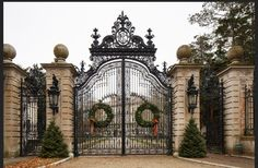 Wreaths adorn the entrance to the Breakers, which sits on a breathtaking knoll of Rhode Island coast.  Bob O'Connor for The Wall Street Journal