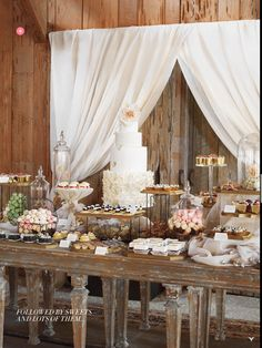 like the dessert table setup with tiers, not sure about curtain behind