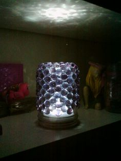 Mason jar lamp...touch light inside, glass marbles gluegunned to the outside...so pretty!