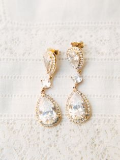 Double diamond gold dangle earrings: http://www.stylemepretty.com/texas-weddings/tomball/2017/02/16/the-prettiest-shades-of-purple-for-a-vintage-farm-wedding/ Photography: Michelle Boyd - http://www.michelleboydphotography.com/