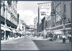 Read's Drug Store (right), at the southeast corner of Howard and Lexington streets. Baltimore, Maryland in 1962.