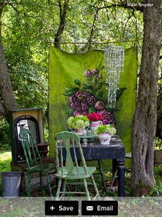 Colors repeated are the hanging canvas, chair color, flowers & trees