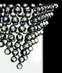 Pyramid made of crystal balls. Beautiful chandelier.