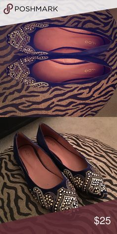 Violet suede flats with gold and silver detail! I love these gorgeous flats. Only worn once, I have to part with them because although they are a size 9, they run small- would fit an 8.5 comfortably. Beautiful gold and silver beading. Aldo Shoes Flats & Loafers