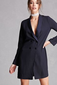 A longline woven blazer by Twelve™ features a double-breasted front closure, slim lapels, and long sleeves. (This item runs small, please size up.)