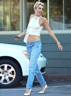 Ripoff Artist Miley Cyrus wore torn jeans and a halterneck top while heading to lunch with a pal in Studio City, Calif. July 5.