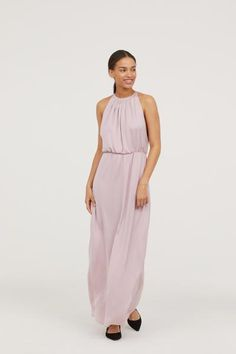 858f3aceddab Long halterneck dress in woven fabric with a sheen in a narrow cut at the  top with pleats at the front. Open section with lace trims at the back,  covered bu