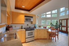 Contemporary Kitchen with Stone Tile, L-shaped, Flush, Breakfast bar, High ceiling, Simple granite counters, Limestone Tile