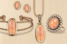 """The latest addition to the Avon Signature Collection. Antiqued metals are embellished with large faceted simulated stones for a classic, designer look. Goldtone features a peach stone; silvertone has a black stone.16.5"""" necklace includes a 3"""" extender for a longer look. Stud earrings, ring and bracelet complete the collection."""