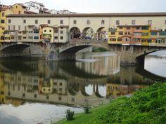 Reflexion of Ponte Vecchio in the Arno river