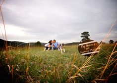 white-ranch-park-golden-colorado-outdoor-photojournalistic-engagement-photography-with-dog-sitting-in-grass