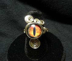 Eye Ring - Adjustable Steampunk Wire Wrap LOTR Lord of the Rings Orange Eye of Sauron Glass Eye Ring by Nixcreations, $25.00