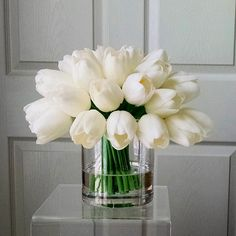Handcrafted. 38-40 Real Touch Tulips; acrylic water; glass container.  Approximately, 9D x 9T. Container: 3.5 Diameter 4 Tall Real Touch Flowers / Natural Touch Flowers are the very best in artificial flowers. Floramatique® real to the touch flowers look and feel incredibly realistic.  This elegant and simple faux-floral arrangement features real touch tulips carefully arranged in glass container. Perfect size for bedroom side table, bathroom vanity top, coffee table or home office. It will…