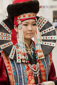 Traditional costume at Mongolia's Naadam festival - faces of the people...and looks like a friend