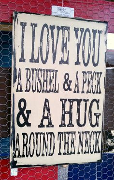 Vintage distressed sign, I love you a bushel and a peck. $45.00, via Etsy.