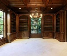 Office - love the wood bookcases and that ceiling!