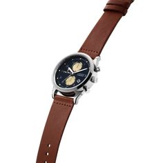 The clean chronograph. Designed in polished stainless steel with a navy blue dial. Comes with a brown Swedish organically tanned leather strap.
