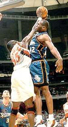 Jerry Stackhouse is blocked by Dikembe Mutombo