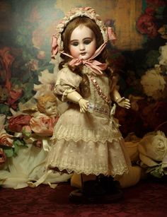 Mark: DEP 5     This is a angelic 14 petite French antique Bebe from the 19th century having a sweet expression with beautiful mohair eyelashes and