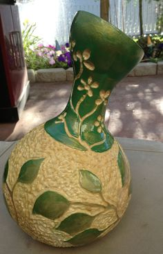 Home grown gourd, carved and painted!