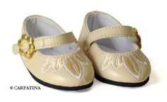 """Petals Shoes - Fits 18"""" American Girl Dolls by Carpatina Dolls. $7.99. Fits 18"""" American Girl Dolls. Cream leather shoes with embroidered petals and gold buckle. Shoes are about 3"""" long and 1.50"""" wide. From the Manufacturer                Fashionable shoes made in creamy colored leather like material with a embroidered flower petals and gold flower buckle.                                    Product Description                Cream leather Ballet Flats with embroidered flowe..."""