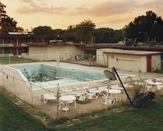 Photographer J Bennett Fitts traveled through the US to find these abandoned motels pools and capture the emptiness of these venues that were once places of happiness. // 'No Lifeguard On Duty' by John Bennett Fitts