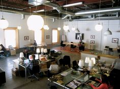 Love the lamps on the desks and overhead lighting, also nice open floor plan