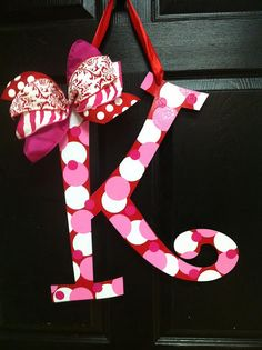 Put your family 's initial on the front door in a Valentine Theme! (Valentine's Day Wreath) by Claudia Basinger Valentine Theme, Valentine Day Wreaths, Valentine Decorations, Valentine Day Crafts, Happy Valentines Day, Holiday Crafts, Holiday Fun, Valentine Ideas, Valentine Colors