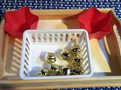 jingle bell sort. take the bead out of some of the bells. kid sorts the bells that jingle in one bowl and the ones that don't jingle in another.