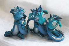 Silver and Turquoise Dragons by BittyBiteyOnes.deviantart.com on @deviantART