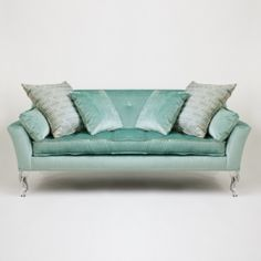 my second favorite sofa. I am obsessed with the acrylic cabriole legs!