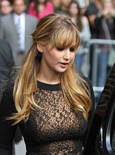 Jennifer Lawrence hairstyles: Down vs. half-back