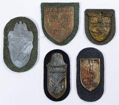 Lot 335: World War II German Sleeve Shield Assortment; Five Nazi sleeve shields representing Narvik, Cholm, Kuban, Balkan and Demjansk campaigns