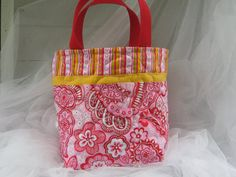 Cute church bag for a kid-- Kids handmade quilted bag, Girls tote bag, lunch bag, book bag, gift bag. $18.00, via Etsy.