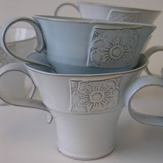 Nina Pärnerteg. Interesting cup mug shape. Handle. Etching. Carving.